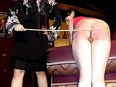 Beautiful brunette is spanked brutally OTK and with the cane