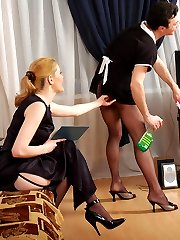 Salacious sissy French maid bobs up and down on babe�s strap-on on the sofa