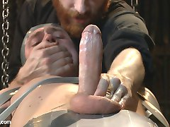 Straight stud Zane Anders finds himself belted down to a ladder, balanced against the wall of a...