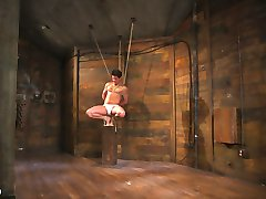 New House Dom Jordan Boss is hot, muscular, and equipped with a deliciously thick cock and a sadistic hunger for power that few can match! Eager to punish, Jordan finds House slave 996 awaiting him as a welcoming gift - and because no gift can be given without proper presentation, slave 996 is wrapped indeed; bound and struggling on a tiny pedestal at the mercy of his Dom. Jordan wastes no time removing 996's jock, and begins punching and manhandling his writing gift before bending him over the pedestal and clubbing his toned ass with a rubber baton, relishing in his slave's screams of agony and pleasure. Next Jordan binds his slave to large, unyielding pieces of bamboo and flogs him mercilessly before fucking 996's eager mouth with his domineering rock hard cock, demanding his submission and making him beg for a good hard fucking. Once the new Dom has had enough fun punishing his slave, he sets to work on his exceptionally tight asshole, slowly easing his dick farther and farther in until both studs are fucking in sheer exstacy. After railing his slave's ass into the dungeon floor, Jordan blows his huge hot load all over the place and finally permits 996's release as well.