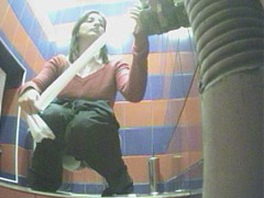 Hot babes emptying their bladders in mall toilet