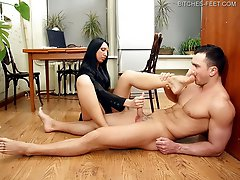 Anna\'s slave is lying at her feet and she\'s trying to finish her work with the computer. She orders her slave to start licking her feet. When she\'s no satisfied with how he works with his tongue she spits to his face or slaps him. Then she starts playing