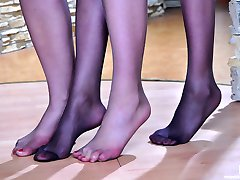 Leggy girls step out of their heeled sandals for lesbian nylon foot play