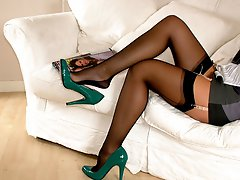 Black nylon stockings and sexy green high heels on this babe