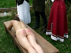 Naked and ashamed - 2 girls caning punishments while tied down to a bench - searing stripes