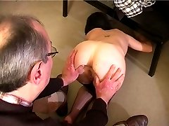 Pretty girl in stockings gets a shameful spanking on her bared buttocks