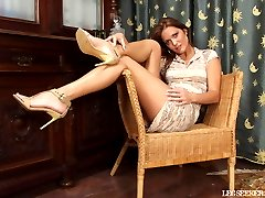 Rebecca shows off her lovely legs in the chair