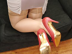 Cute babe Lauryn flashes her shapely legs and gorgeous red bowed high heels shoes