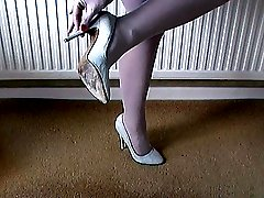 Michelle who knows all about shoe fetish is talking to you about wanking your cock whilst she...