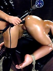 Kelly Divine\'s ass is just out of control. It\'s hard to even pay attention to anything but her ass if she\'s in a five mile radius. Isis ties that booty up, shocks it, fucks it with metal dildos and a big black strap-on, spanks it, and gets to touch it all day long! She also humiliates this lactating hottie by milking her tits like a cows udders and cattle proding her ass like a piece of ill behavied livestock. Hot lesbian BDSM with strap-on sex, bondage, and electro-play!