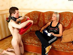 Boxer babe uses a slave as punching bag and makes him lick her smelly feet
