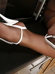 Awesome gal in shiny pantyhose demonstrating her lovely feet in the kitchen