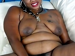 Chubby black girl gets it on with a dildo