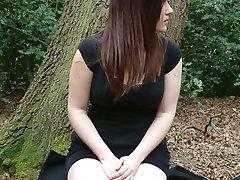 UK brunette masturbates against a tree