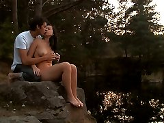 On the edge of the lake, these barely legal teens become one. His cock gently pushes deep inside...