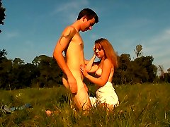 She is the picture of innocence, but this teen has some x-rated desires. Soon, she`s giving this lucky stud a blowjob and a whole lot more in the middle of this field.