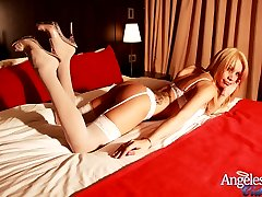 Hot Blonde Shemale naked in bed with an erection