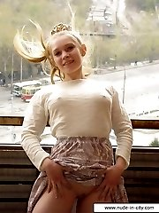 Teen babe shows her pussy at the balcony