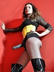 Femdom Strap On Dildo Jane plays with her fat strapon cock clad in fishnets, boots and yellow corset