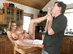 Naughty Jaylyn Rose slips into a bodystocking and gets erotic foot worship in the kitchen