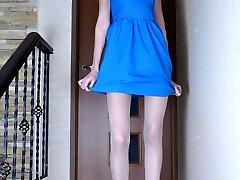 Frisky damsel unbuckles her strappy sandals to showcase her slender nyloned feet