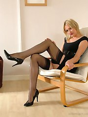 Gorgeous blonde Caroline attaches her suspender belt to her sexy nylons, and then can't resist a tease of her long stockinged legs and high heels
