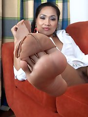 Hot nylon sheathed feet are slowly revealed and offered for respectful worship!