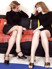 Sexy babes petting each other with polished feet clad in open toe hose