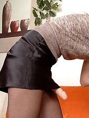 Kinky sissy guy hiking up his skirt and kneeling down for strap-on screwing