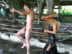 Ugly teenage mistress in leather crushes her slave like a worm