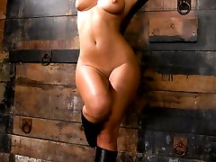 Mistress Sandra Romain taunts Lefty while he suffers in painful predicament with his hard cock tied to a wall and a hook up his ass pulling in the opposite direction.   When the pain becomes too much, he is bent over and fucked up the ass to strip his manhood, and finally his cock is used and drained for Mistress' pleasure.