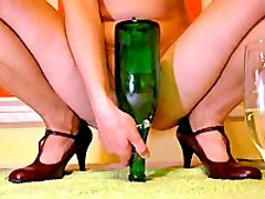 Extreme whore fucks an entire champagne bottle