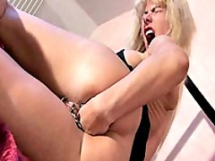 Heavily pierced slut brutally fisted and fucked with a giant dildo