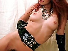 Horny redhead model unzips her dress to unleash her bouncy tits and hairy pussy slit