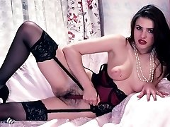 Breasty dark-haired in stockings nastily showing off her bushy pussy
