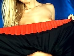 Horny blonde lifting her short red skirt to rub her moist muff!