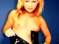 Innocent blonde in black latex