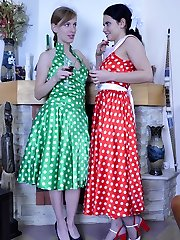 Two pretty girls in retro style gowns enjoy backside finger-tickling and strapon anal