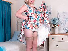 she's in sexy vintage bra and deep garter belt, real 50's glamour! Her nylons, sheer fully fashioned, make her so horny!