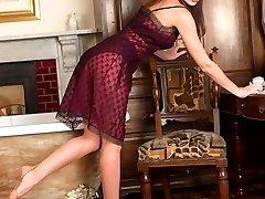 Sophia is demonstrating how women trim their pussies in her vintage nylons!