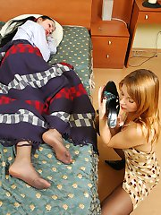 Sleepy chick eagerly licking pantyhose clad legs in stiletto heel sandals
