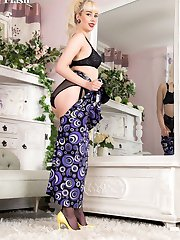 Dressed in a eye catching gown, see Emily play and strip down to a cute German floral garter belt, nylons and heels.