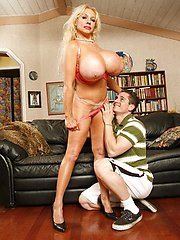 Blonde milf Echo Valley with massive tits sucking a cock before taking it between her tits and tight pussy