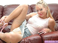 busty blonde MILF strips on the couch