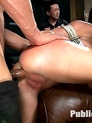 Pretty brunette Mia Gold has done a few BDSM scenes in her life, but she's never done anything like this before.  We take her to a bar in San Francisco and pour drinks on her then strip her down and finger her in the bathroom, where the girls in line to pee are disgusted by what a whore she is.  She gets dragged through the bar and fondled by hundreds of strangers before being made to to suck cock, pussy fucked, ass fucked, and fingered by strangers on the bar, ice poured on her and fisted with her face in the laps of strange men.  Some of the girls in the bar get in on the action, and get a caning lesson on Mia's feet.  Finally, used up, Mia gets tossed onto the pool table and left behind, covered in three loads of cum.