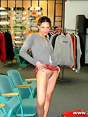 Punker chick nude in a skate shop