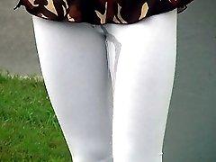 Miss in wet leggings walks in the street