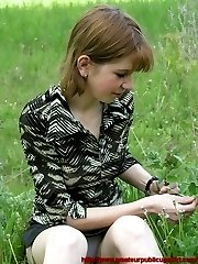 All busy studying the grass this cutie let her short skirt ride up revealing her sexy white panties