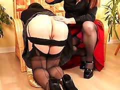 After getting bored watching her TGirl friend reading, tranny bitch Luci May decides to spank her ass and suck her cock to make things more interesting