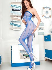 In a fishnet combo of blue body suit and open crotch white net tights, Becky is 100% dressed for pleasure!